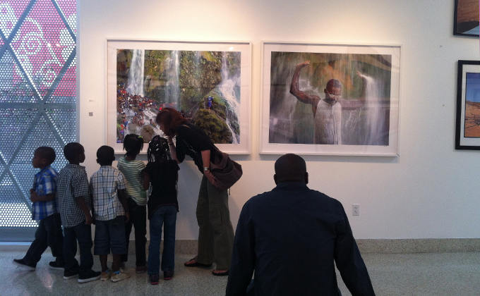 Elementary school children visit an exhibit at the Little Haiti Cultural Center.